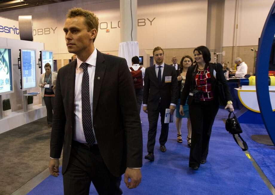 Norwegian petroleum minister Ola Borten Moe walks through the product floor during the Offshore Technology Conference at Reliant Center Monday, May 6, 2013, in Houston. (Cody Duty / Houston Chronicle) Photo: Cody Duty, Houston Chronicle