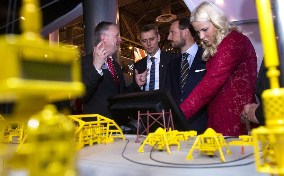 FMC Technologies Tore Halvorsen, left, talks to Norwegian petroleum minister Ola Borten Moe, Norway's Crown Prince Haakon and Crown Princess Mette-Marit, right, during the Offshore Technology Conference at Reliant Center Monday, May 6, 2013, in Houston. (Cody Duty / Houston Chronicle) Photo: Cody Duty, Houston Chronicle