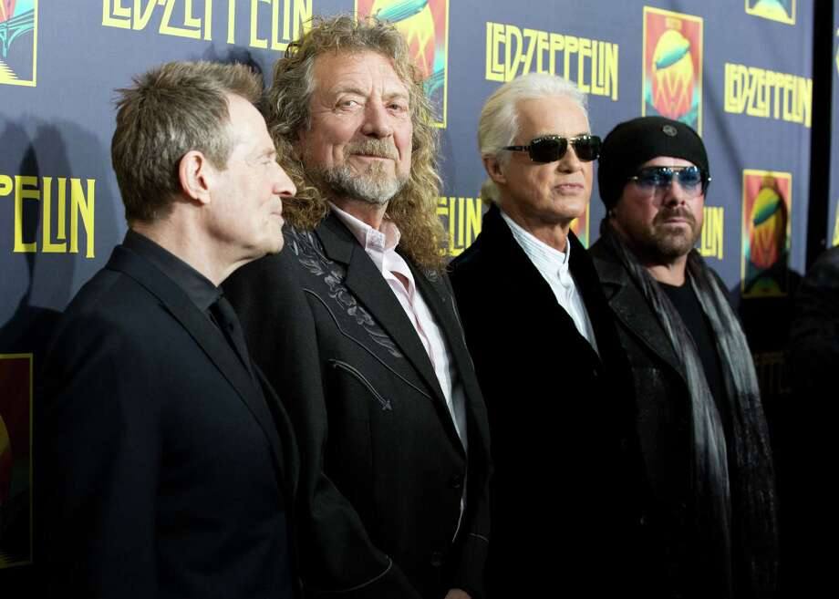 "FILE - This Oct. 9, 2012 file photo shows musicians, from left, John Paul Jones, Robert Plant, Jimmy Page and Jason Bonham at the""'Led Zeppelin: Celebration Day"" premiere in New York. CBS' ""60 Minutes"" webcast reported Monday, May 6, 2013, that former President Clinton was enlisted to ask the British rock band to get back together last year for the Superstorm Sandy benefit concert in New York. He asked, they said no. David Saltzman of the Robin Hood Foundation says he and film executive Harvey Weinstein flew to Washington to ask Clinton to make the plea. Led Zeppelin's surviving members Robert Plant, John Paul Jones and Jimmy Page were in Washington just before the Sandy concert for the Kennedy Center Honors. Led Zeppelin last played publicly at a one-night reunion in London in 2007.  (Photo by Dario Cantatore/Invision/AP, file) Photo: Dario Cantatore"