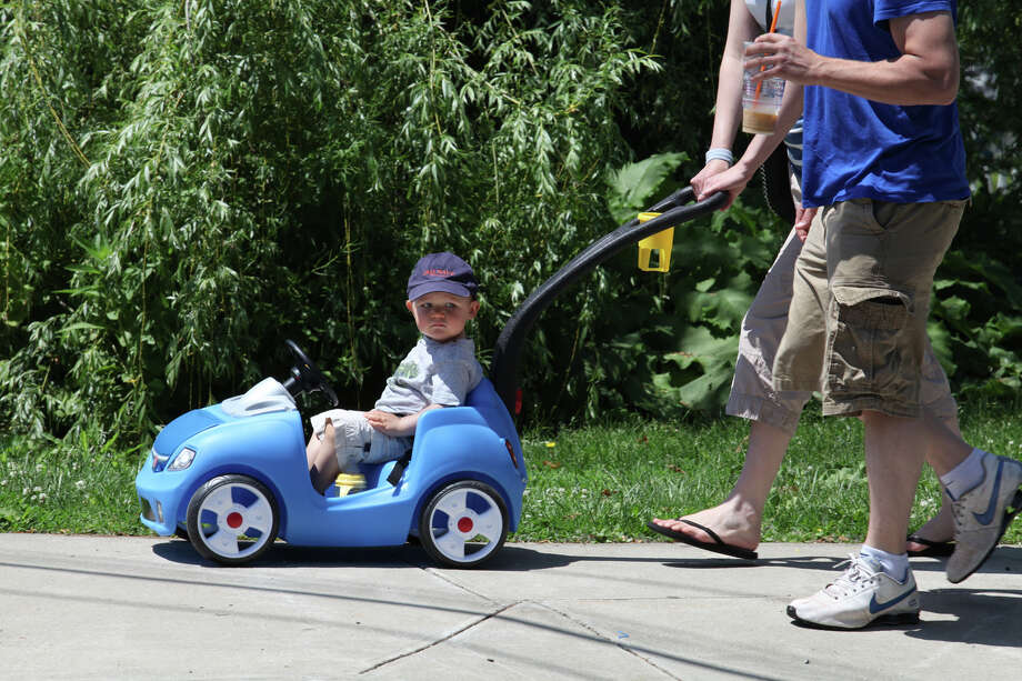 Logan Ames, of Hamden, goes for a car ride with his parents, Lauren Sardi and Todd Ames, in downtown Milford on Sunday, June 2, 2013. Photo: BK Angeletti, B.K. Angeletti / Connecticut Post freelance B.K. Angeletti