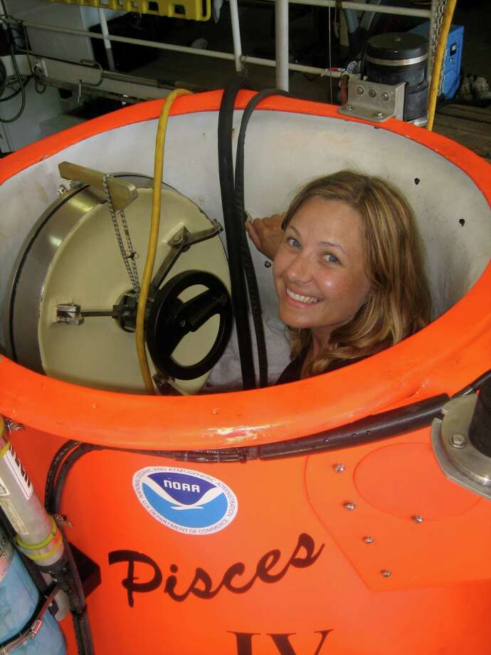 "Devon Chivvis, a documentary filmmaker from New Canaan, peers out from the entry hatch of a submergence vehicle. Chivvis and her husband Mark Fowler's film ""Hunt for the Samurai Subs"" will be shown at the New Canaan Historical Society in an event sponsored by Staying Put. Photo: Contributed"
