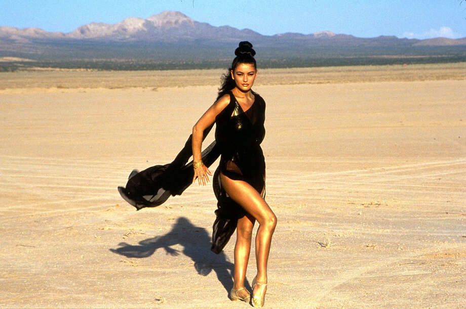 Before her breakthrough role in ''The Mask of Zorro,'' Catherine Zeta-Jones was doing this music video in 1992 for her song, ''For All Time.'' It was part of the musical version of ''Spartacus.'' Photo: Ron Wolfson/WireImage, WireImage / WireImage