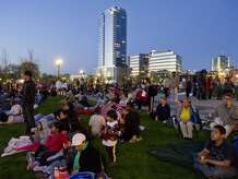Area residents gather to watch a movie at Mill River Park in Stamford on Friday, May 3, 2013.