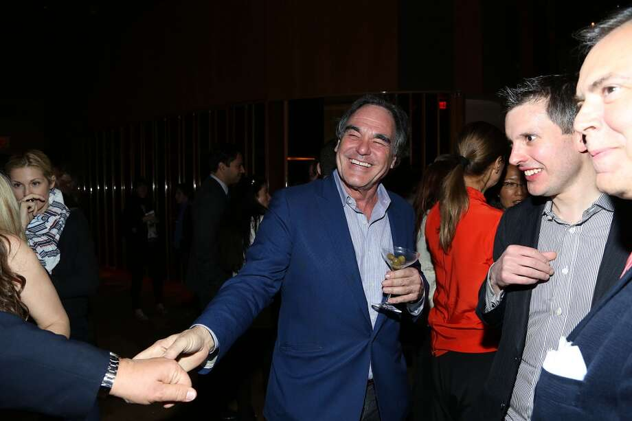 "NEW YORK, NY - MAY 05:  Oliver Stone attends the pre-Met Ball special screening of ""The Great Gatsby"" after-party at The Top of The Standard on May 5, 2013 in New York City.  (Photo by Rob Kim/Getty Images)"
