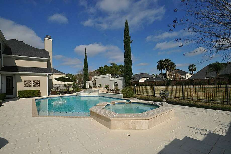 The pool area features a spa and attractive landscaping. Photo: RE/MAX Westside Realtors