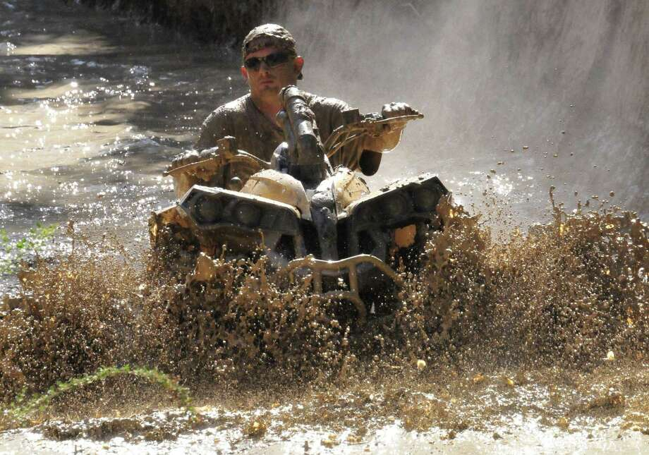 The Hardin County MusicFest in Kountze featured ATV muddin , helicopter rides and live entertainment. The event was hosted at the Big Thicket Trade Days on U.S. 69. Photo: Cassie Smith