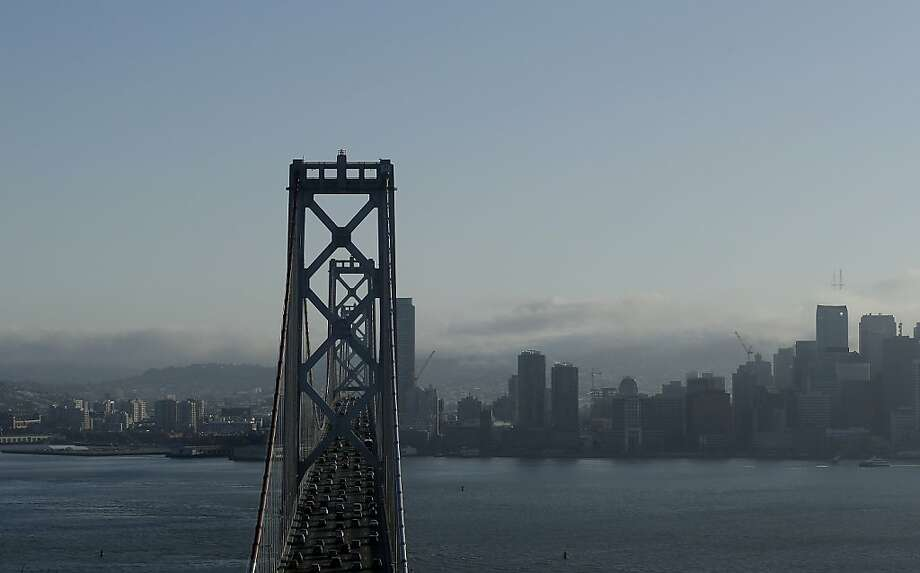 Safety of the Bay Bridge - the west span is shown at left - will be reviewed by state agencies and the Federal Highway Administration. Photo: Jeff Chiu, Associated Press