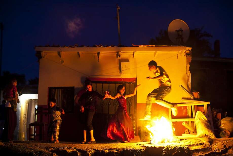 Hot foot hop: A young Turkish gypsy leaps over flames during the celebration of the Hidirellez spring 
