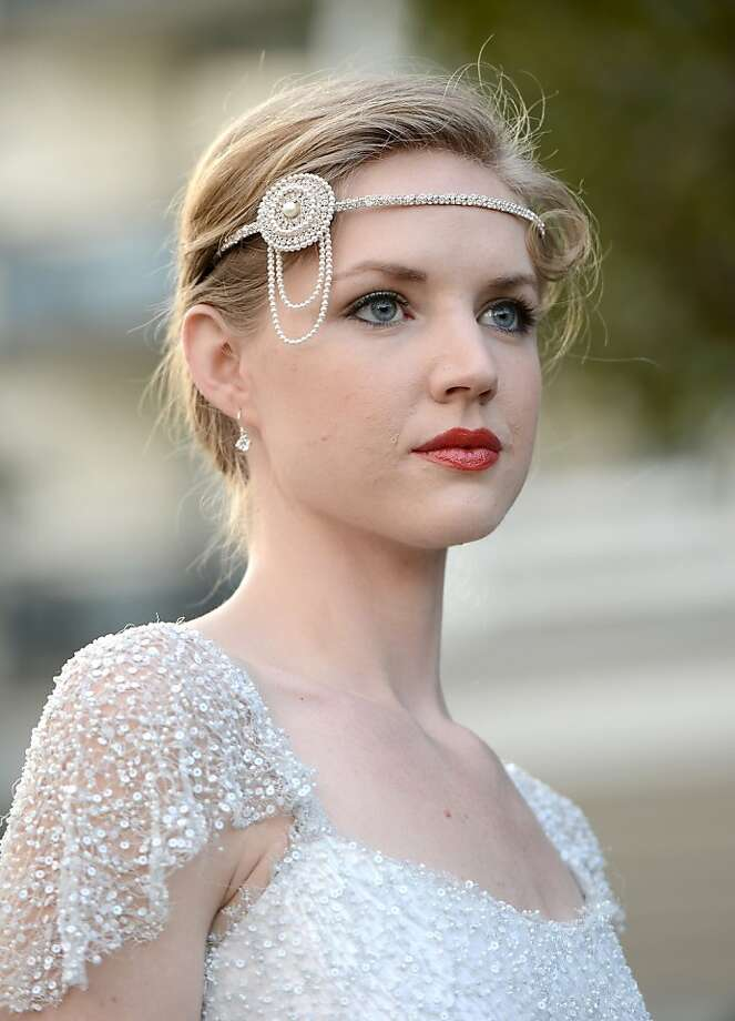 """Flapper flair:A model with much less facial hair shows a """"Downton Abbey""""-inspired design during BritWeek at the Fairmont Miramar Hotel in Santa Monica, Calif. Photo: Kevin Winter, Getty Images For BritWeek"""