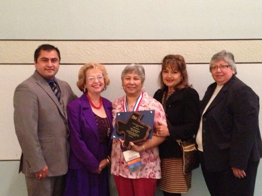 Lydia Torres-Tucker (center), was named Texas Librarian of the Year at the Texas Library Association conference in Fort Worth. She is pictured with, from left, Ramiro Nava, Luisa Sandoval, Helen Madla and Rebecca Robinson. Photo: Courtesy Photo