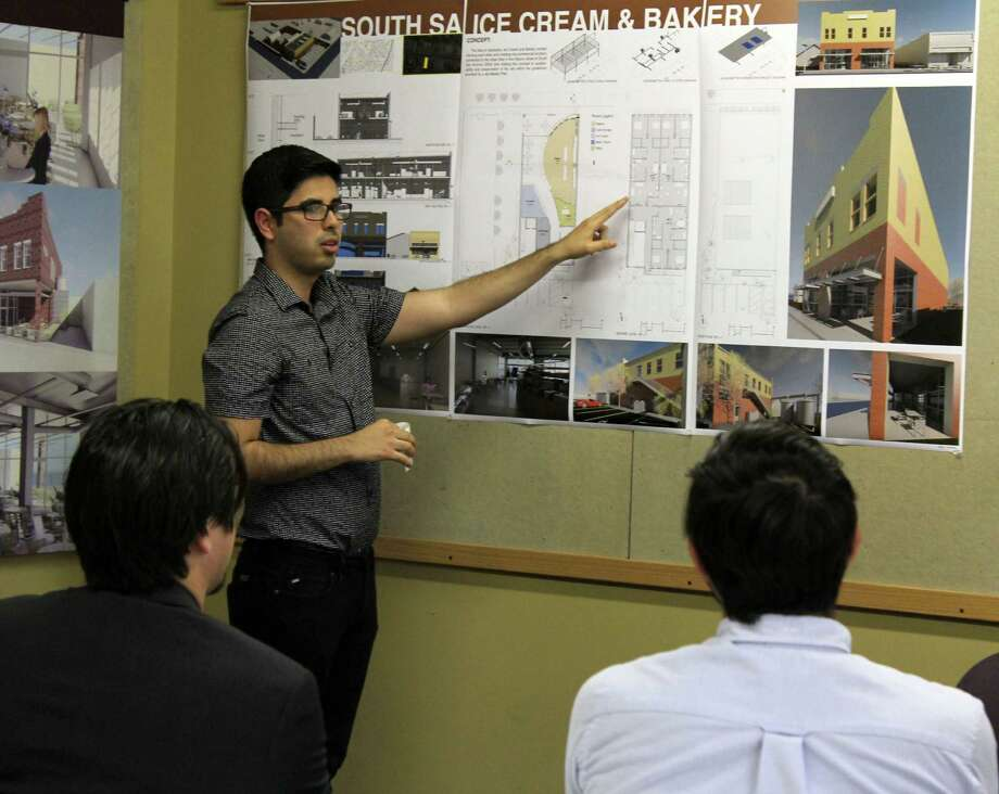 UTSA architect senior Hugo E. Sánchez describes his plans to Gilbert Morales and Andy Castillo for a ice cream and bakery shop as a part of a semester-long exercise in partnership with the South San Main Street Project. Photo: Melody Mendoza/ For The Southside Reporter