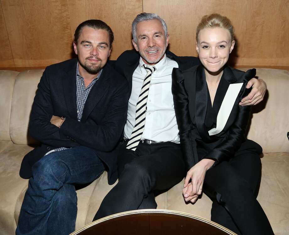 "(L-R) Actor Leonardo DiCaprio, director Baz Luhrmann and actress Carey Mulligan attend the pre-Met Ball special screening of ""The Great Gatsby"" after-party at The Top of The Standard on May 5, 2013 in New York City.  (Photo by Rob Kim/Getty Images)"