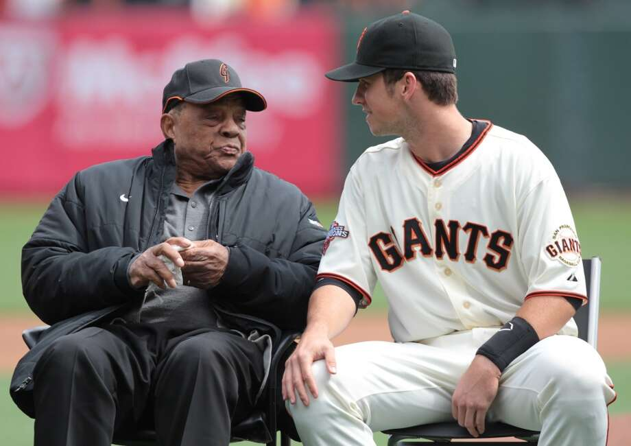 Buster Posey talks with Willie Mays at an awards ceremony for the 2012 MLB MVP award in San Francisco, on Saturday, April 6, 2013.