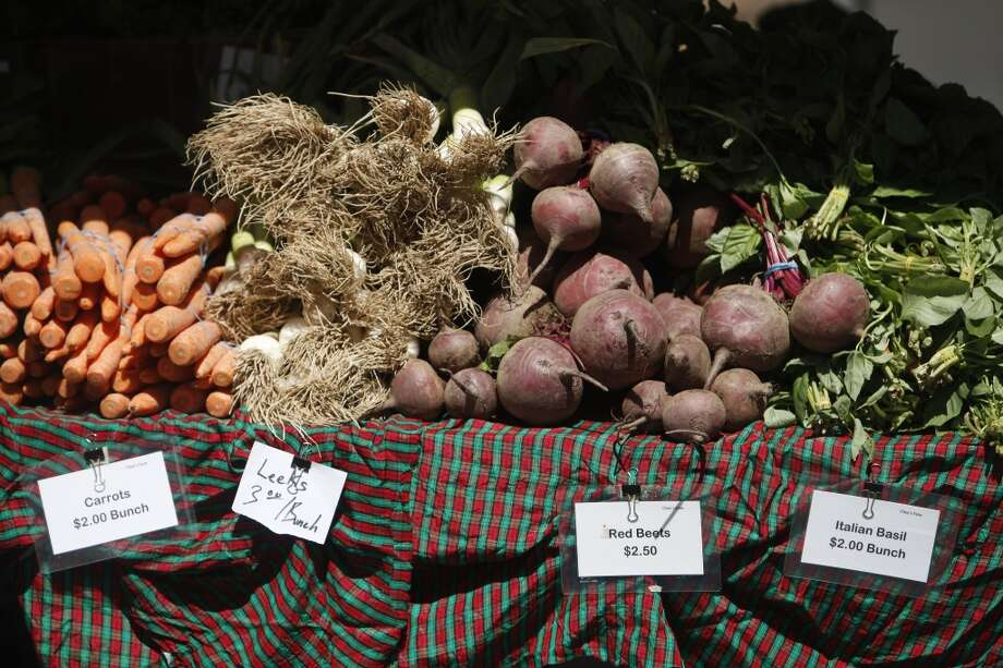 Carrots, leeks, red beets and Italian basil are displayed at Chue's Farm Fresh Vegetables.