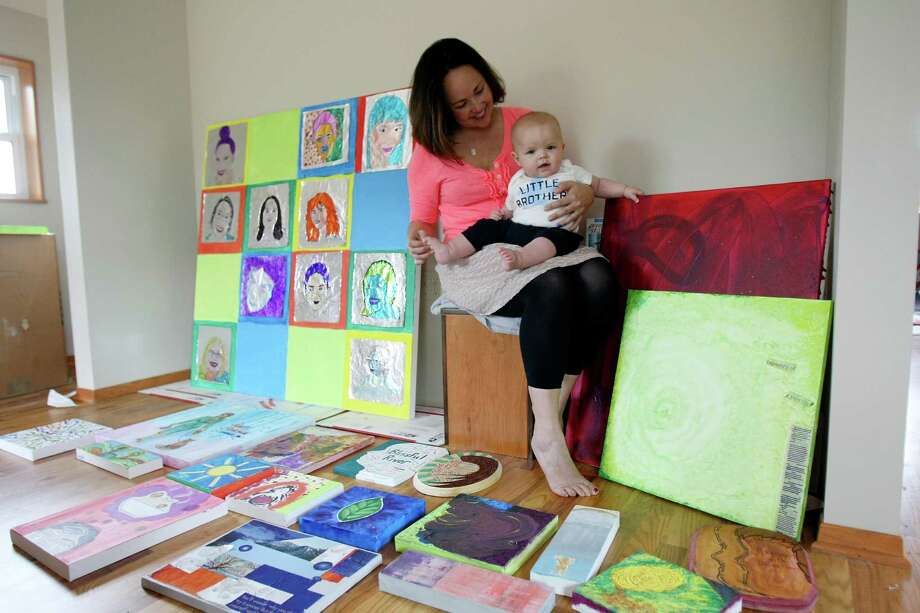 Kim Murray McDonald, with her son Wyatt, is founder of the Zoetica Project, which involves 12 local mothers who produced art during a nine-month workshop. Photo: Photos By Helen L. Montoya, San Antonio Express-News / ©2013 San Antonio Express-News