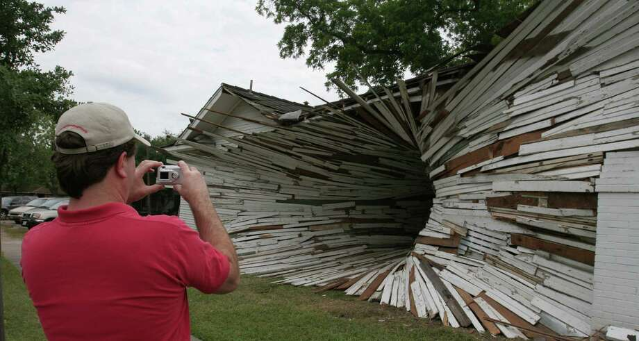 """""""Inversion,"""" in 2005, was made from the bungalows slated for demolition to make way for the Art League's new building. The sculpture was temporary -- but for years, it lived on as a mural at its namesake coffeeshop, next door to Art League Houston at the sculpture's old site. Photo: Gary Fountain, For The Chronicle / Freelance"""