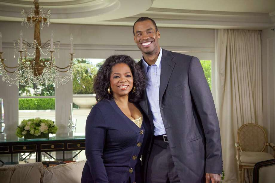 "This May 1, 2013 photo released by OWN shows host Oprah Winfrey posing with NBA  basketball player Jason Collins during an interview for ""Oprah's Next Chapter,"" in Beverly Hills, Calif.  The interview aired Sunday. Officials at three publishing houses said Monday, May 6, that they had been contacted about a planned memoir by Collins, the first active player in any of four major U.S. professional sports leagues to come out as gay.  (AP Photo/OWN, Chuck Hodes) Photo: Chuck Hodes"