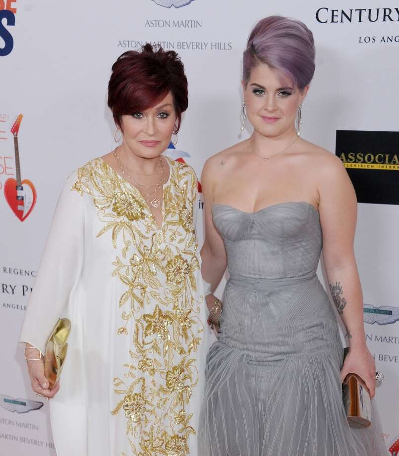 TV personalities Sharon Osbourne and Kelly Osbourne arrive at the 20th Annual Race To Erase MS Gala 'Love To Erase MS' at the Hyatt Regency Century Plaza on May 3, 2013 in Century City, California.  (Photo by Gregg DeGuire/WireImage)