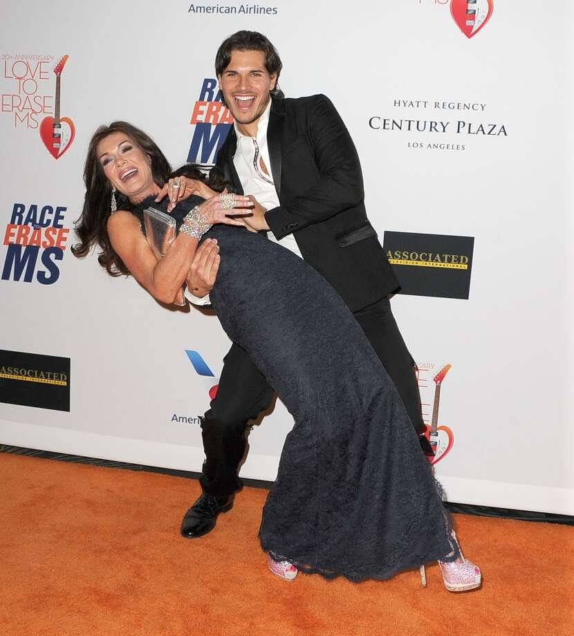 "CENTURY CITY, CA - MAY 03:  Gleb Savchenko and Lisa Vanderpump arrives at the 20th Annual Race To Erase MS Gala ""Love To Erase MS"" at the Hyatt Regency Century Plaza on May 3, 2013 in Century City, California.  (Photo by Steve Granitz/WireImage)"