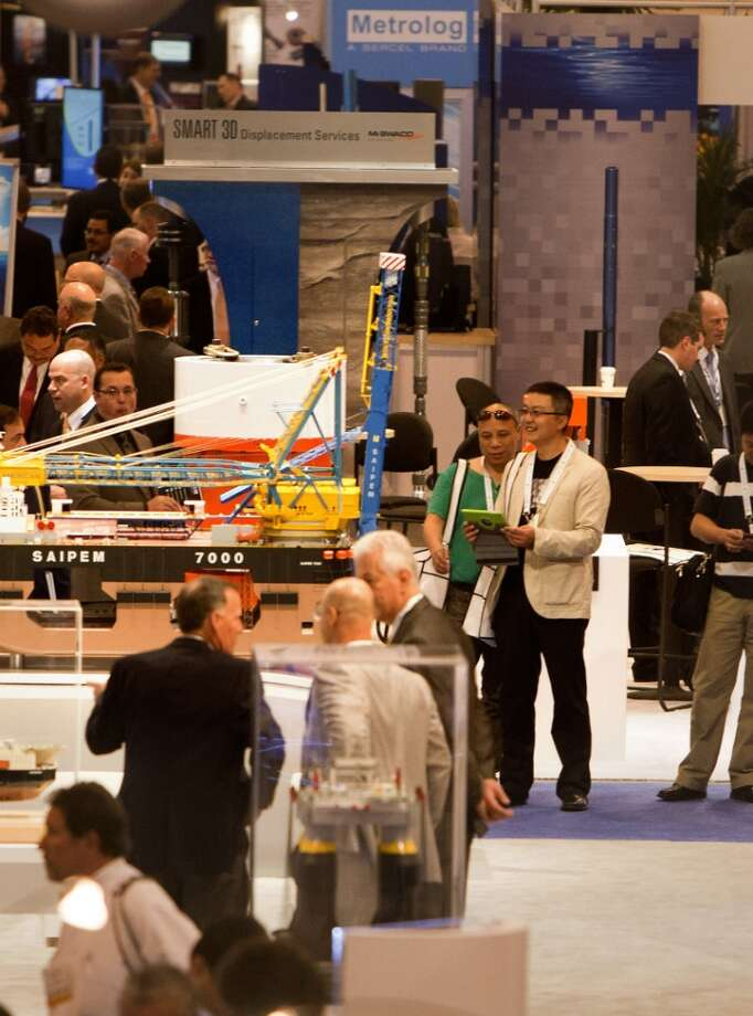 Customers look at products on display during the Offshore Technology Conference at Reliant Center Monday, May 6, 2013, in Houston. (Cody Duty / Houston Chronicle)
