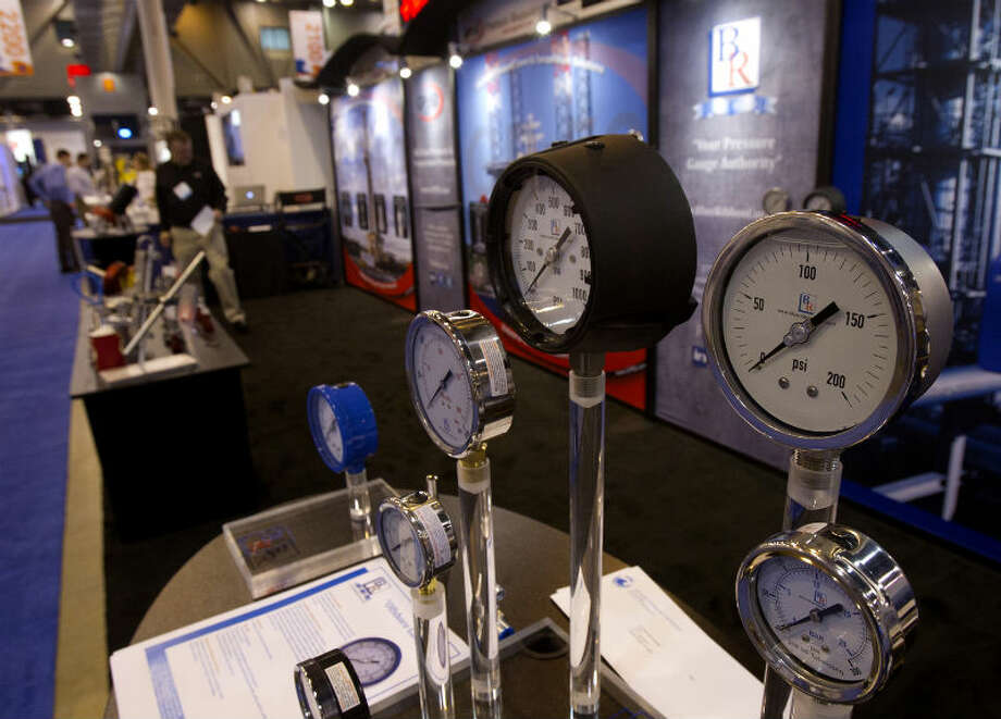 Oil pressure gauges are seen during the Offshore Technology Conference at Reliant Center Monday, May 6, 2013, in Houston. (Cody Duty / Houston Chronicle)