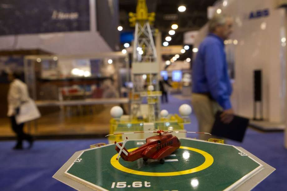 A model helicopter sits atop a model BT - UDS Ultra Deepwater Drillship during the Offshore Technology Conference at Reliant Center Monday, May 6, 2013, in Houston. (Cody Duty / Houston Chronicle)