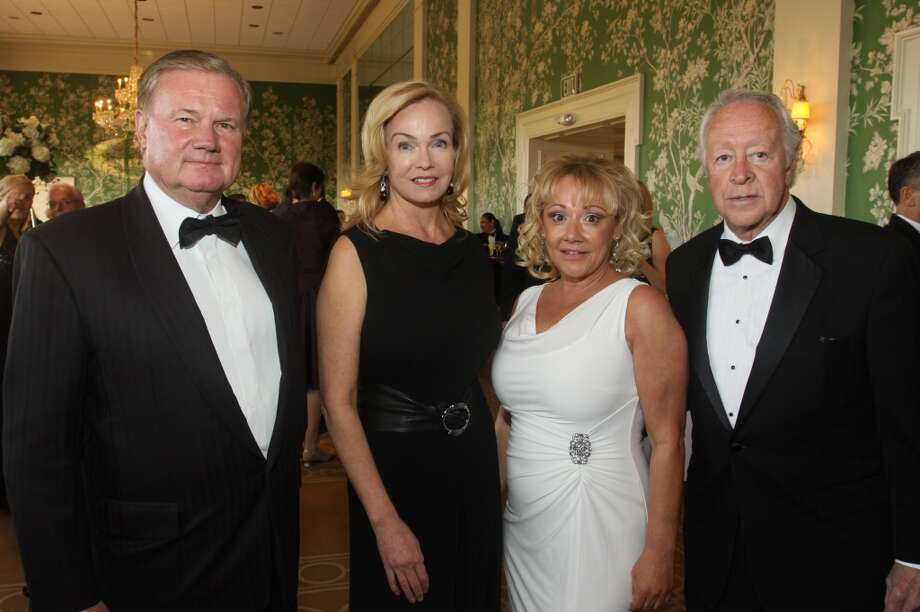 Chairs Keith and Alice Mosing, from left, Laura True and Judge Michael McSpadden.