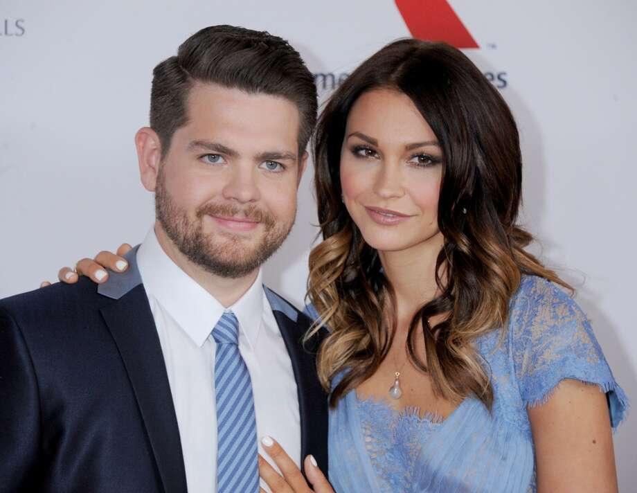 TV personality Jack Osbourne and wife Lisa Stelly arrive at the 20th Annual Race To Erase MS Gala 'Love To Erase MS' at the Hyatt Regency Century Plaza on May 3, 2013 in Century City, California.  (Photo by Gregg DeGuire/WireImage)