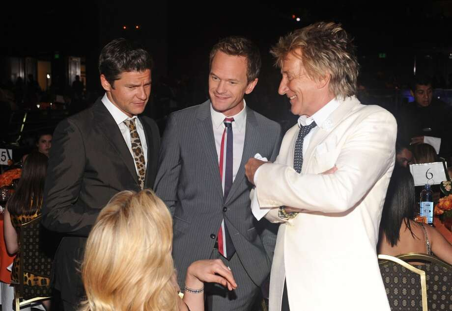 "CENTURY CITY, CA - MAY 03: David Burtka, actor Neil Patrick Harris, and musician Rod Stewart attends the 20th Annual Race To Erase MS Gala ""Love To Erase MS"" at the Hyatt Regency Century Plaza on May 3, 2013 in Century City, California.  (Photo by Stefanie Keenan/Getty Images for Race To Erase MS)"