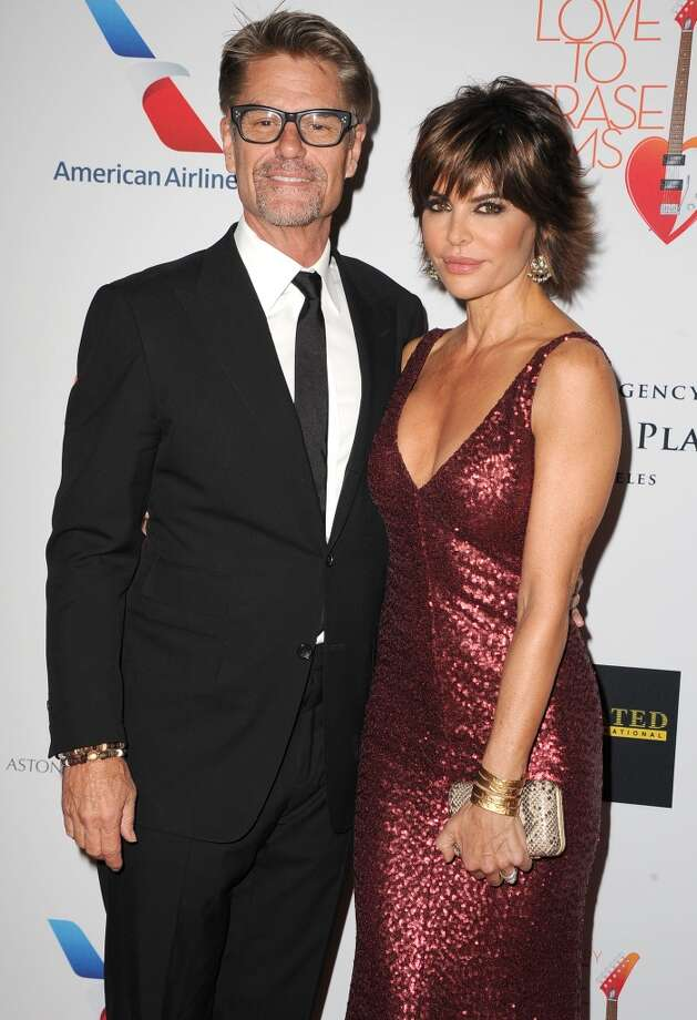 "CENTURY CITY, CA - MAY 03:  Harry Hamlin and Lisa Rinna arrives at the 20th Annual Race To Erase MS Gala ""Love To Erase MS"" at the Hyatt Regency Century Plaza on May 3, 2013 in Century City, California.  (Photo by Steve Granitz/WireImage)"