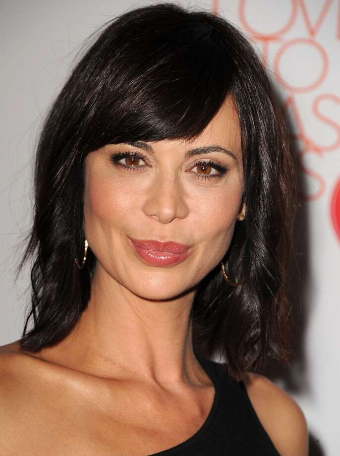"CENTURY CITY, CA - MAY 03:  Catherine Bell arrives at the 20th Annual Race To Erase MS Gala ""Love To Erase MS"" at the Hyatt Regency Century Plaza on May 3, 2013 in Century City, California.  (Photo by Steve Granitz/WireImage)"