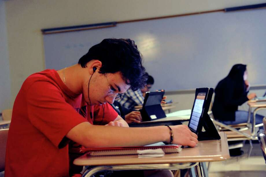 Patrick Jarosz, 10th grade, works on his tablet at American history class at Greenwich High School, in Greenwich, Conn., Monday May 6, 2013. Photo: Helen Neafsey / Greenwich Time