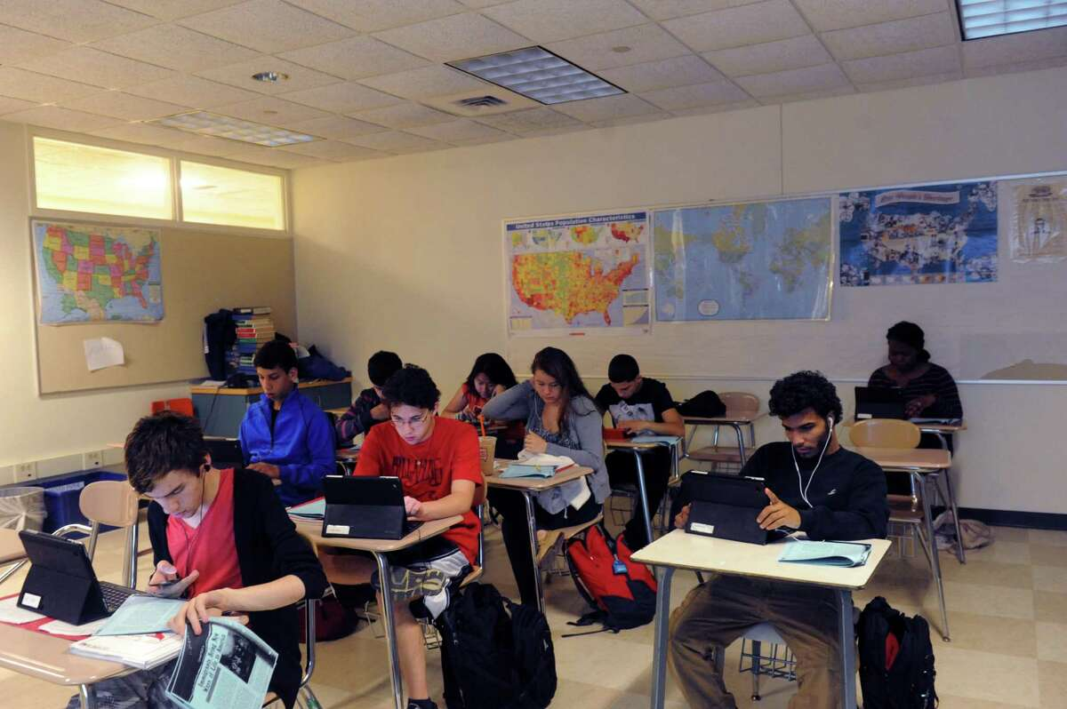Tenth grade students work on their tablet at American history class at Greenwich High School, in Greenwich, Conn., Monday May 6, 2013.