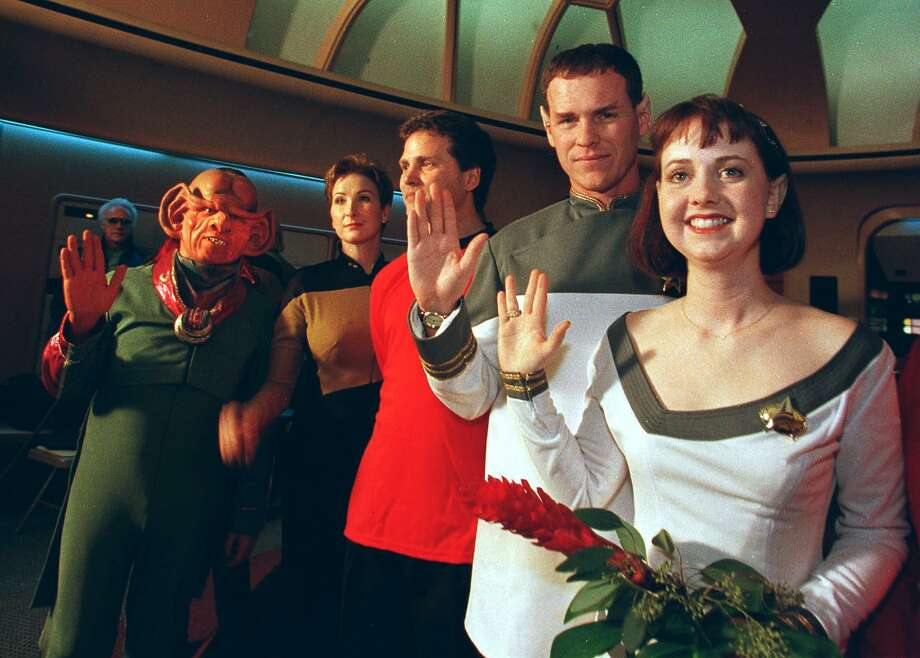 "Craig and Mikel Salsgiver display the Vulcan greeting after renewing their vows on Valentine's  Day -- their fifth wedding anniversary -- on the bridge of the Starship Enterprise at ""STAR TREK: The Experience"" attraction at the Las Vegas Hilton in 2009. Photo: JOHN GURZINSKI, AFP/Getty Images / AFP"