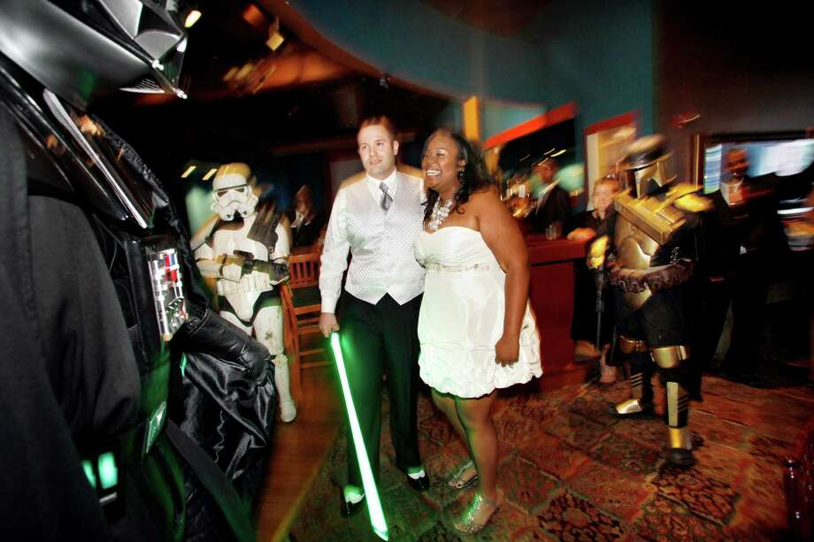 """""""Star Wars Day,"""" May 4 (as in """"May the fourth be with you""""), was a fitting time for Janice Bold and Chris Bold to hold their Star Wars-themed Wedding in Surrey, British Columbia. With wedding season fast approaching, this made us think of the many ways couples can make their special day all that much more, um, memorable. Here's Jeremy Pryor and Domonique Williams' Star Wars wedding, in 2011, in Baltimore. Photo: The Washington Post, The Washington Post/Getty Images / 2011 The Washington Post"""
