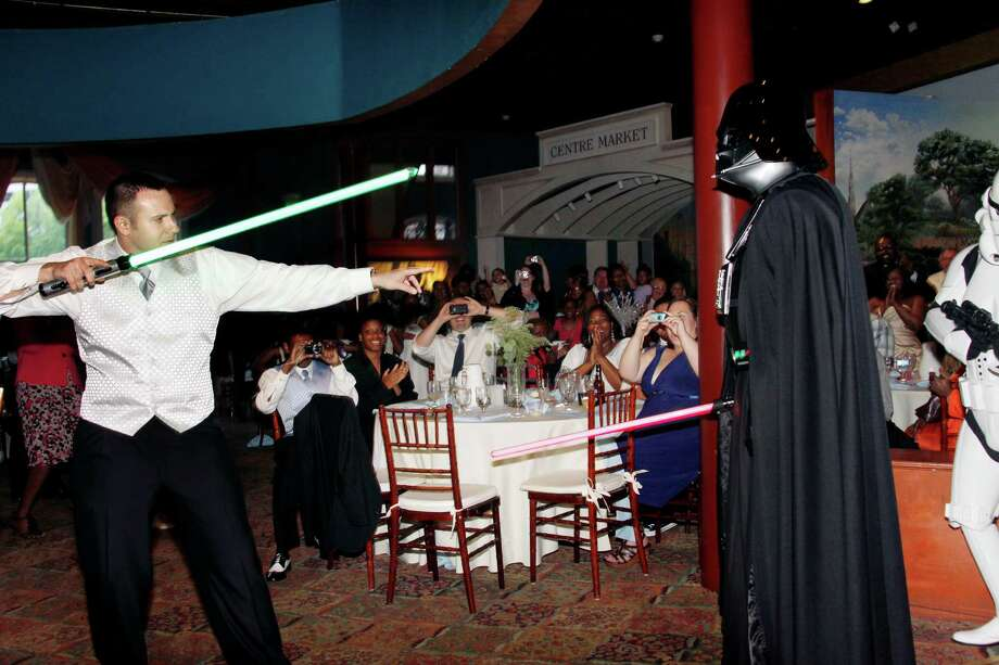 "Jeremy Pryor had to ""fight"" Darth Vader for bride Domonique Williams during his Star Wars wedding in Baltimore in 2011. Photo: The Washington Post, The Washington Post/Getty Images / 2011 The Washington Post"