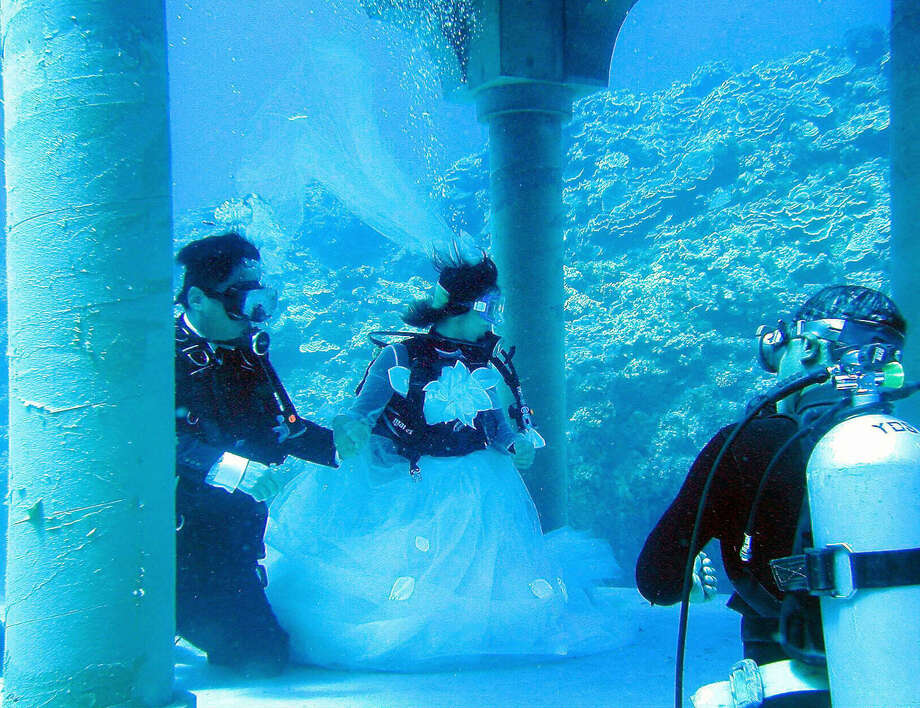 The government of Yoron island, Japan, built this underwater wedding site to promote the resort island. Photo: JIJI PRESS, AFP/Getty Images / 2003 AFP
