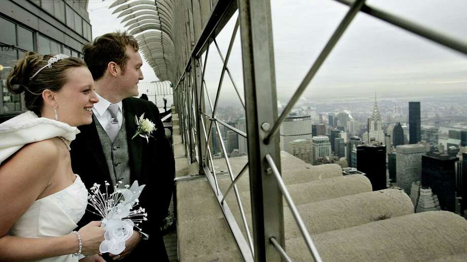 Of course, there are other ways to get high up for your wedding. Brittany and Ian Hunt, of Potsdam, N.Y., wed atop the Empire State Building on February 14, 2005. Photo: Stephen Chernin, Getty Images / 2005 Getty Images