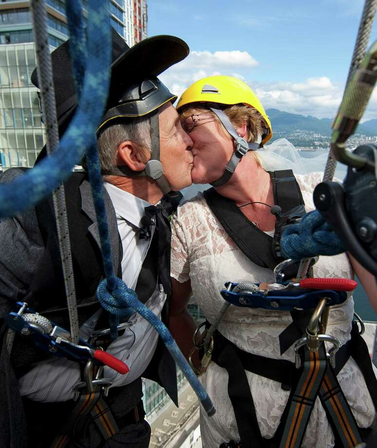 Rick Harker, 64, and Marlene Hoar, 55, did them one better, repelling down the side of a skyscraper as part of their wedding ceremony September 15, 2009 in Vancouver, British Columbia. Photo: Jeff Vinnick, Getty Images / 2009 Getty Images