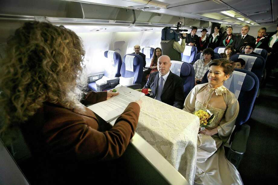 Getting married in an airplane isn't quite as adventurous as it was in the early days of flight. Photo: NELSON GARRIDO, AFP/Getty Images / 2007 AFP