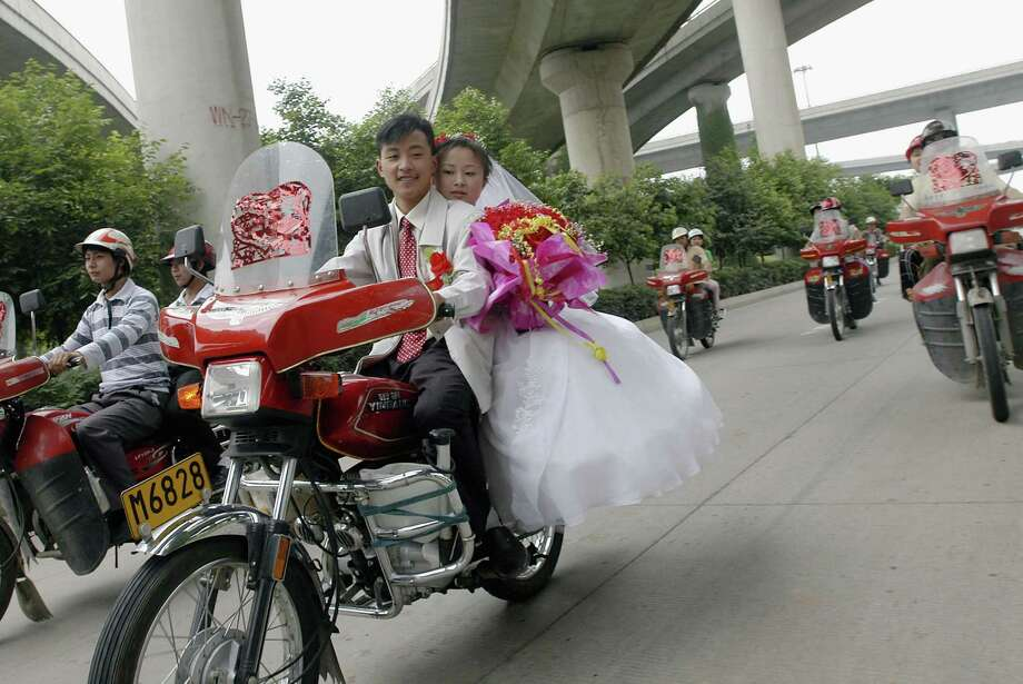 Motorcycle weddings can be fun. Photo: China Photos, Getty Images / 2005 China Photos