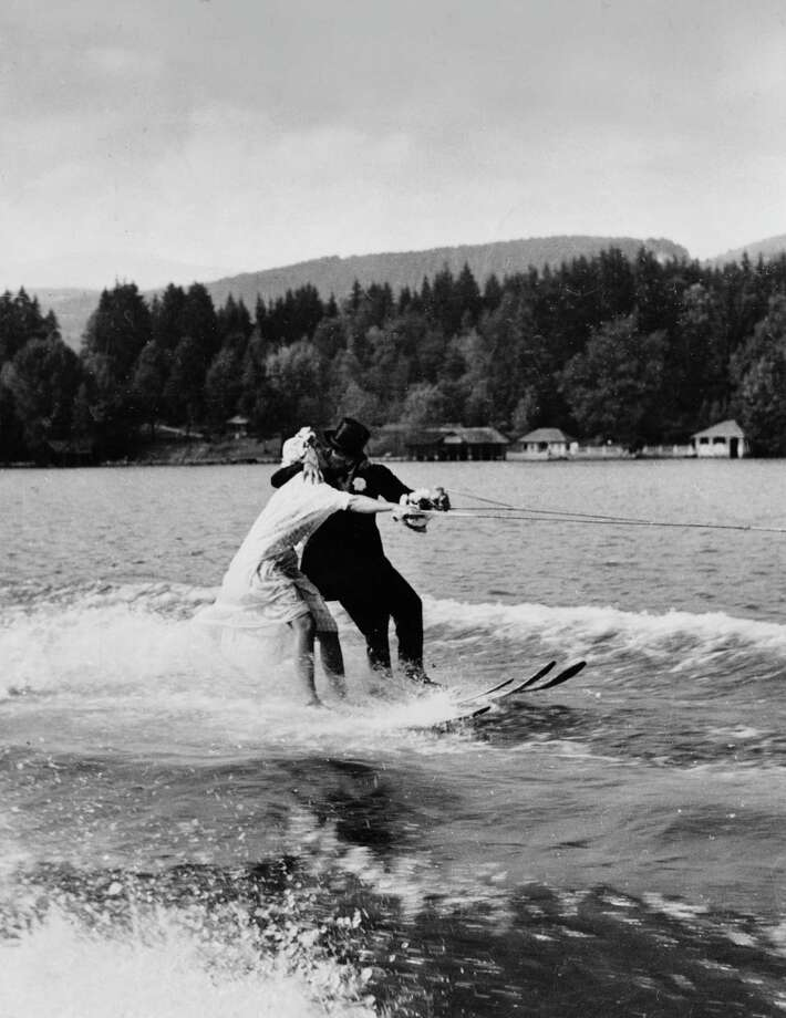 Prefer to be on top of the water? Here, Jannette Burr and Hans Sachs kiss while waterskiing in their wedding attire in Worthersee, Austria, on September 27, 1951. Photo: Paul Popper/Popperfoto, Popperfoto/Getty Images / 2011 Getty Images