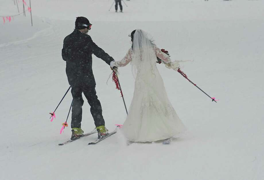 The event is a mass wedding, after which all participants and guests ski or snowboard down the mountain for a party with cake, music and prizes. Photo: Helen H. Richardson, DP / (C) 2011 The Denver Post, MediaNews Group