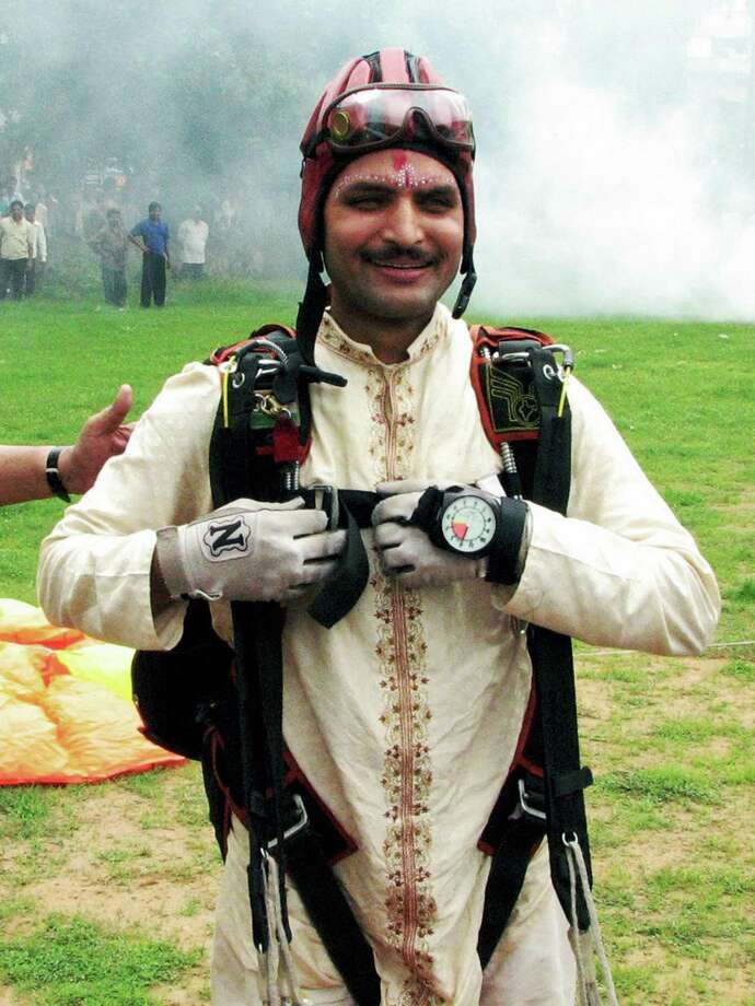 Indian Air-Force official Shisir Mishra arrived at his wedding by parachute in Bhubaneswar, India, on July 13, 2008. Photo: STRDEL, AFP/Getty Images / 2008 AFP