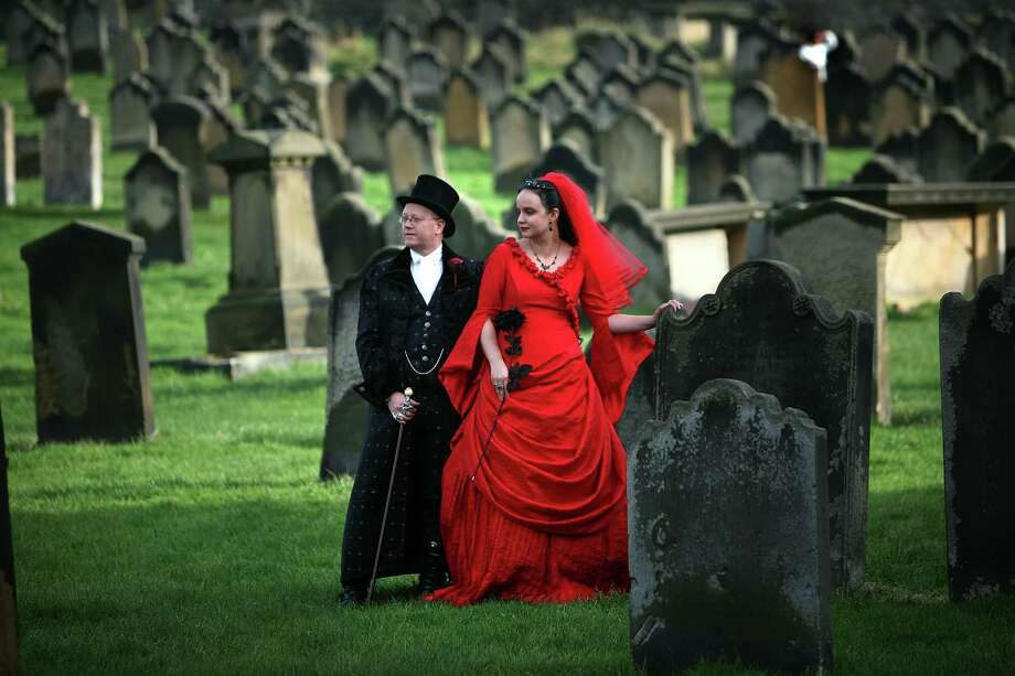 Goths Tony and Angela Lightowler renewed their marriage vows amid the gravestones at St Mary The Virgin Church during Whitby Gothic Weekend on October 27, 2007, Whitby, England. Photo: Christopher Furlong, Getty Images / 2007 Getty Images