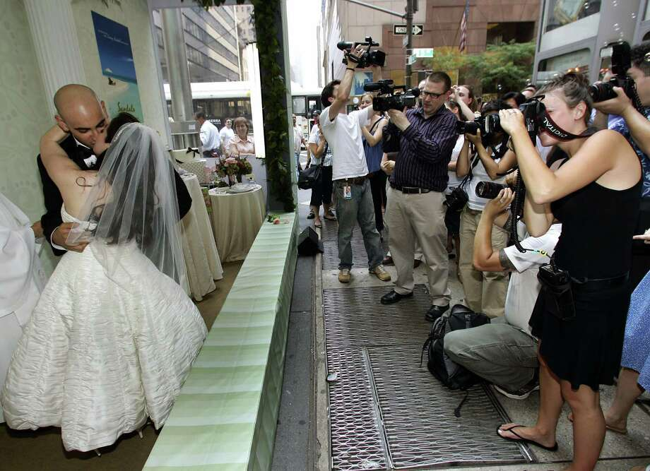 "This was apparently the first-ever ""Wedding in a Box"" ceremony, on Fifth Avenue in New York, in 2007. Photo: TIMOTHY A. CLARY, AFP/Getty Images / 2007 AFP"
