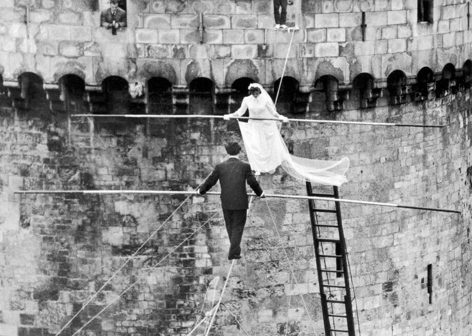 Aerialists Roland Schmidt and Francine Pary married on tightrope stretched between two towers of La Rochelle Harbor, France, on March 22, 1959. Photo: Gamma-Keystone Via Getty Images