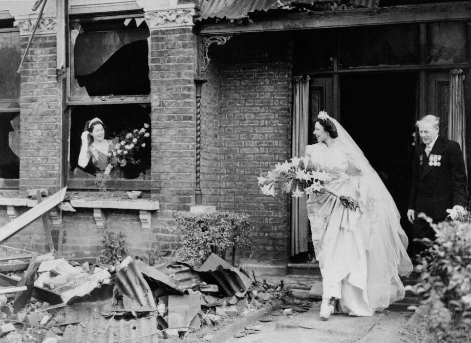 Here's a bride emerging from a bombed house in London in November 1940. Photo: KEYSTONE FRANCE, Gamma-Keystone Via Getty Images / KEYSTONE FRANCE