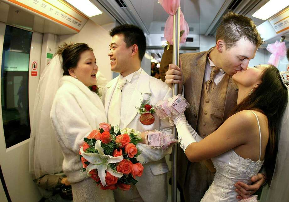 And what's more romantic than a mass wedding aboard a subway train? Photo: China Photos, Getty Images / 2006 China Photos