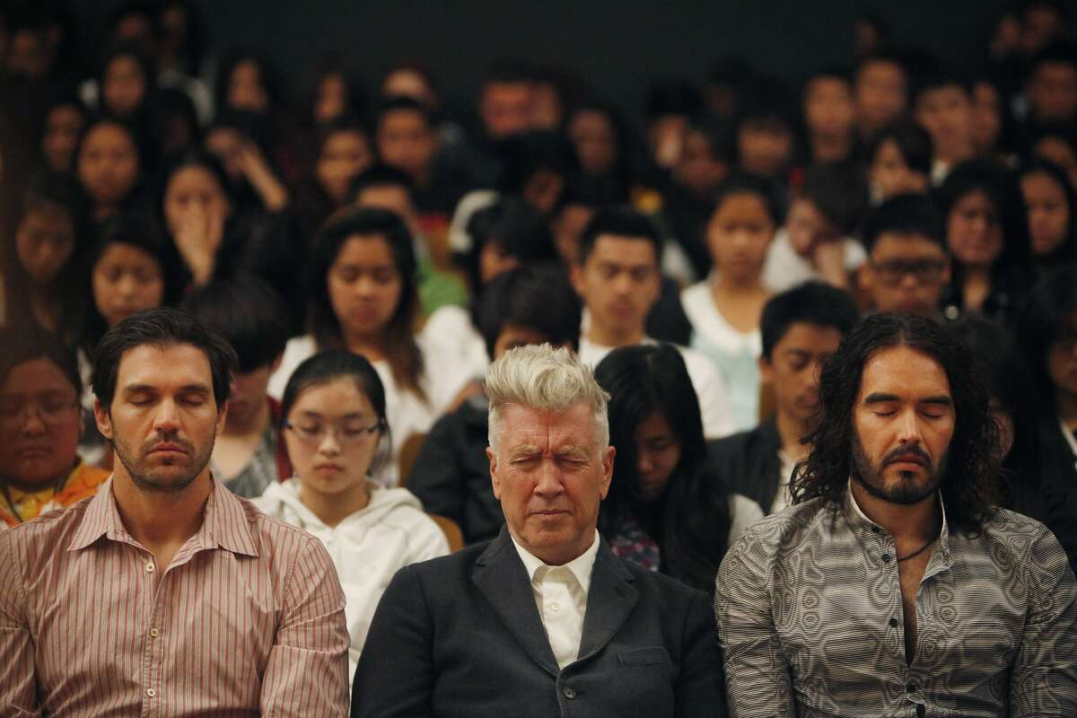 Barry Zito (l to r), of the San Francisco Giants; director David Lynch and actor Russell Brand meditate with students during the 6th anniversary celebration of the San Francisco Unified School District Quiet Time program at Phillip and Sala Burton Academic High School in San Francisco, Calif., on Monday May 6, 2013.